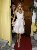 Paris Hilton showing big cleavage in cute white dress leaving restaurant in LA from CelebMatrix