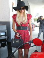 Paris Hilton cleavy and leggy while pumping gas in LA from CelebMatrix