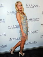 Paris Hilton showing big cleavage in short c-thru dress at Marquee At The Star opening in Sydney from CelebMatrix