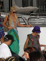 Paris Hilton showing her hot ass in deep cut swimsuit at the yacht in Sydney Harbor from CelebMatrix