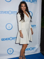 Kim Kardashian showing big cleavage in mini skirt and jacket at the 4th Annual Night of Generosity Gala in Los Angeles from CelebMatrix