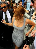 Miley Cyrus busty and leggy wearing no bra in skimpy tight mini dress leaving her hotel in Miami from CelebMatrix