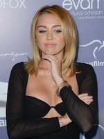 Miley Cyrus showing her hot boobs in bra wearing wide open low cut mini dress at the Australians In film awards  benefit dinner in LA from CelebMatrix