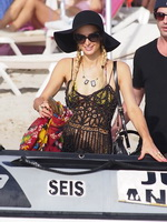 Paris Hilton wearing seethru to bikini preparing to ride jet ski on the beach in Ibiza from CelebMatrix