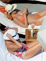 Jessica Alba showing off her hot body in skimpy orange bikini poolside on the Amalfi Coast in Italy from CelebMatrix