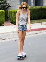 Miley Cyrus showing pokies braless wearing skimpy top and denim shorts while skateboarding in Toluca Lake from CelebMatrix