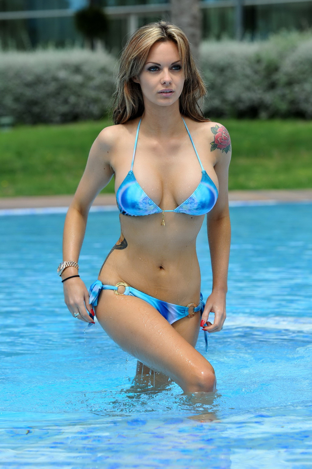 off her curvy body wearing skimpy blue bikini at the pool in i a