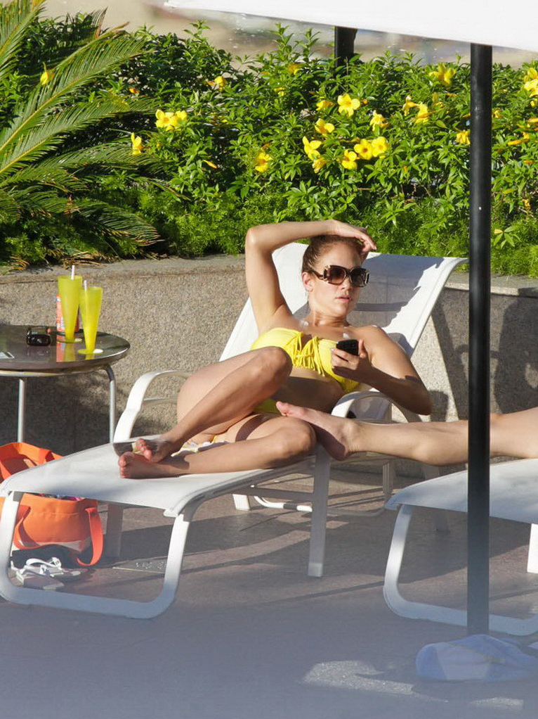 Jennifer Lopez showing off her  toned body wearing strapless canary bikini poolside in Brasil from CelebMatrix