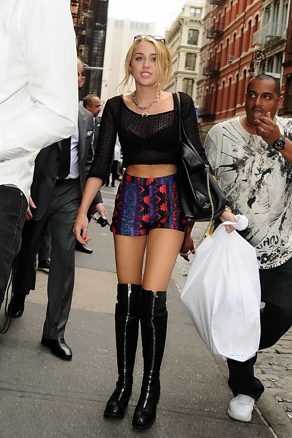 Miley Cyrus busty wearing see-thru belly top and shorts while buying