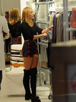 Miley Cyrus busty wearing see-thru belly top and shorts while buying boots in NY from CelebMatrix