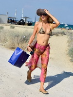 Paris Hilton looking hot wearing leopard print bikini and seethru beach skirt in Saint Tropez from CelebMatrix
