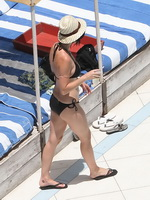 Katy Perry showing off her curvy body in skimpy black bikini at the pool in Miami from CelebMatrix