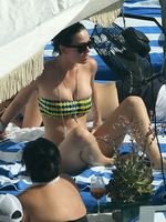 Katy Perry wearing yellow-green strapless bikini at the pool in Miami from CelebMatrix