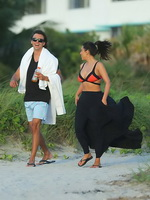 Kim Kardashian showing off her curves wearing skimpy bikini on Miami Beach from CelebMatrix
