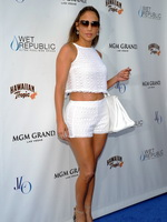 Jennifer Lopez busty and leggy wearing white belly top and shorts on Wet Republic pool party at the MGM Grand in Las Vegas from CelebMatrix