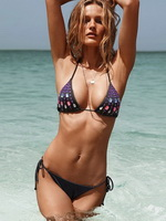 Edita Vilkeviciute showing off her wet bikini body at the beach for Victoria Secret photosession from CelebMatrix