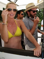 Jennie Garth exposing her hot body in yellow bikini at Azure Pool Party at Palazzo hotel in Las Vegas from CelebMatrix