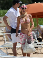 Paris Hilton showing off her perfect bikini body at the beach in Hawaii from CelebMatrix
