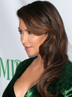 Kim Kardashian shows huge cleavage wearing green high slit dress at Midori Makeover Parlour in Santa Monica from CelebMatrix