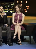 Emma Watson leggy shows cleavage in a short low cut leather dress on the Jonathan Ross Show in London from CelebMatrix
