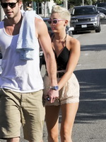 Miley Cyrus braless showing side boob in a partially see-through tiny top and shorts out in Santa Monica from CelebMatrix