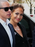 Jennifer Lopez showing big cleavage in a white low cut mini dress at the Chanel fashion show in Paris from CelebMatrix