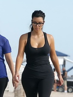 Kim Kardashian showing her huge boobs in tight see-through top and tights while works out  at the beach in Miami from CelebMatrix
