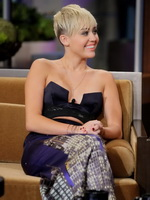 Miley Cyrus braless wears very revealing dress on The Tonight Show with Jay Leno from CelebMatrix