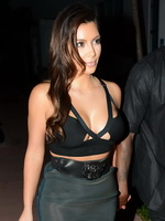 Kim Kardashian busty wearing tiny top and see through skirt   no underwear at Prime 112 in Miami Beach from CelebMatrix