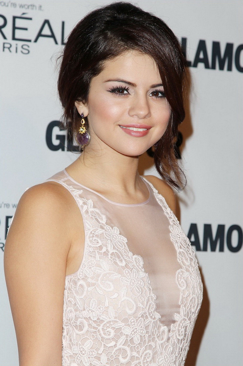 Selena Gomez braless showing huge see-through cleavage in white outfit ...