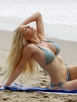 Heidi Montag busty wearing skimpy blue bikini at the beach in Los Angeles from CelebMatrix