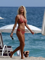 Victoria Silvstedt busty wearing skimpy clover print bikini at the beach in Miami from CelebMatrix