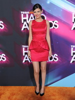 Gorgeous Victoria Justice leggy wearing shiny red mini dress at Nickelodeons 2012 Awards in LA from CelebMatrix