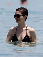 Anne Hathaway wearing wet black bikini at the Setai hotel pool in Miami from CelebMatrix