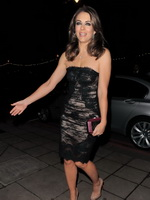 Elizabeth Hurley in short black tube dress arriving at Valentino Master Of Couture VIP view in London from CelebMatrix