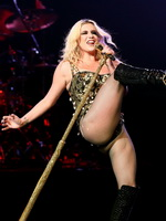 Kesha Sebert showing off her big boobs and flashing shaved pussy in bodysuit and fishnets while performs on the stage from CelebMatrix