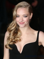 Amanda Seyfried shows off her sexy chest wearing low cut black dress at Les Miserables premiere in London from CelebMatrix
