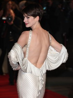 Anne Hathaway looks hot wearing white backless maxi dress at Les Miserables premiere in London from CelebMatrix