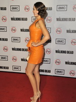 Lauren Cohan stunning in orange leather mini dress at The Walking Dead season 3 premiere from CelebMatrix