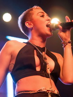 Miley Cyrus in tiny belly top  tights live at Borgore's Christmas Creampies concert from CelebMatrix