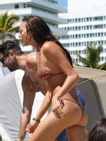 Irina Shayk wearing two thong bikini sets at the beach in Miami from CelebMatrix