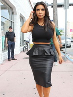 Kim Kardashian showing pokies in tight belly top  leather skirt while arriving at Dash Boutique in Miami from CelebMatrix