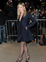 Kirsten Dunst cleavy and leggy wearing black low cut mini dress at On the Road premiere in NYC from CelebMatrix