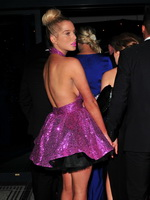 Helen Flanagan braless wearing pink bareback mini dress at James Milner Foundation Ball in Manchester from CelebMatrix