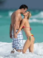 Joanna Krupa wearing colorful thong bikini on the beach in Miami from CelebMatrix