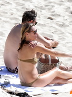 Kate Moss nipple slip wearing olive tube bikini at the beach in St.Barts from CelebMatrix