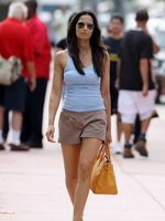 Padma Lakshmi wearing skimpy top  shorts walks back from the beach to her hotel in Miami from CelebMatrix