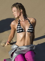 Jennifer Hawkins wearing tiny bikini top  diving suit at the beach shooting from CelebMatrix