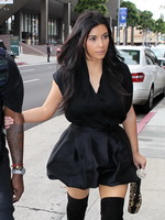 Kim Kardashian cleavy and leggy in black mini dress at Kung Pao Bistro in West Hollywood from CelebMatrix