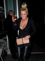 Helen Flanagan showing her massive cleavage in a black top and tight pants out in Mancesther from CelebMatrix